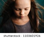 a girl with closed eyes | Shutterstock . vector #1103601926