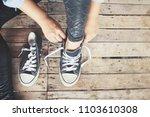legs and sneakers | Shutterstock . vector #1103610308