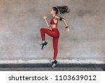 sportswoman jumping and... | Shutterstock . vector #1103639012