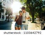 happy explorer couple walking... | Shutterstock . vector #1103642792