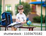 cute little schoolboy studying... | Shutterstock . vector #1103670182