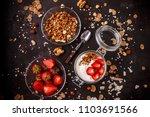 tasty granola with yogurt and... | Shutterstock . vector #1103691566