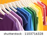 rainbow clothes on hangers... | Shutterstock . vector #1103716328