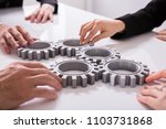 group of businesspeople joining ... | Shutterstock . vector #1103731868