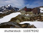Picturesque highest peaks on Lofoten islands in Norway with mountain hut - stock photo