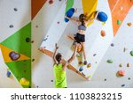 rock climbers in climbing gym.... | Shutterstock . vector #1103823215