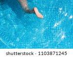 child splashing in the cool... | Shutterstock . vector #1103871245