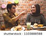 muslim couple breaking fast... | Shutterstock . vector #1103888588