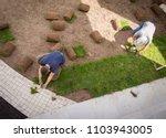 gardener installing natural... | Shutterstock . vector #1103943005