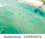 an aerial view of a surfer... | Shutterstock . vector #1103943476