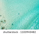an aerial view of a surfer... | Shutterstock . vector #1103943482