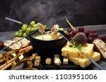 gourmet swiss fondue dinner on... | Shutterstock . vector #1103951006
