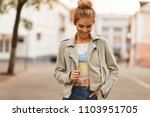 fashionable young stylish woman ... | Shutterstock . vector #1103951705