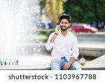 young handsome indian man speak ... | Shutterstock . vector #1103967788