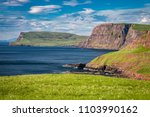 view to shore and cliff in isle ... | Shutterstock . vector #1103990162