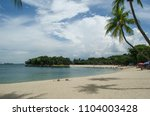 sentosa beach in singapore with ... | Shutterstock . vector #1104003428