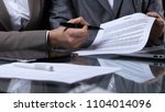 businesspeople or lawyers... | Shutterstock . vector #1104014096