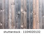 the texture of the wooden fence.... | Shutterstock . vector #1104020132