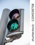 gay themed traffic light in... | Shutterstock . vector #1104038708
