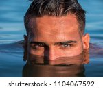 attractive young shirtless...   Shutterstock . vector #1104067592