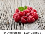 raspberry on wooden board | Shutterstock . vector #1104085538