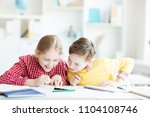 curious schoolboy looking at... | Shutterstock . vector #1104108746