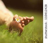 Daisy And Bare Feet On Green...