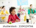 cute schoolboy with pencil... | Shutterstock . vector #1104124766