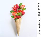 bouquet of strawberries and... | Shutterstock . vector #1104129098