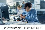 electronics engineer works with ... | Shutterstock . vector #1104131618