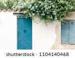 house white facade wall with... | Shutterstock . vector #1104140468