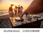 dj playing music at a beach... | Shutterstock . vector #1104148688