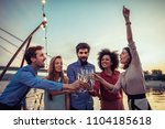 cropped shot of a group of... | Shutterstock . vector #1104185618
