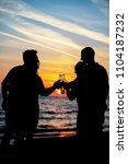 young adult summer beach party... | Shutterstock . vector #1104187232