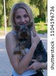 beautiful blonde woman holding...   Shutterstock . vector #1104196736