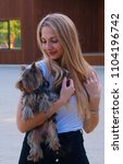 beautiful blonde woman holding...   Shutterstock . vector #1104196742