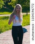 beautiful blonde girl in a...   Shutterstock . vector #1104196772