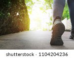 close up woman running shoes ... | Shutterstock . vector #1104204236