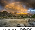 landscape. moody clouds and... | Shutterstock . vector #1104241946