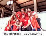 group of fans dressed in red... | Shutterstock . vector #1104262442