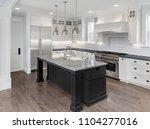 beautiful kitchen in new luxury ... | Shutterstock . vector #1104277016