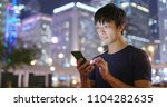 man use of cellphone in city at ... | Shutterstock . vector #1104282635