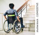 a disable man on wheelchair....   Shutterstock . vector #1104320765