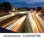 car traffic at night in neu ulm ... | Shutterstock . vector #1104330788