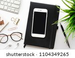 top view of smartphone on... | Shutterstock . vector #1104349265