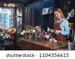 young florist with a bouquet of ... | Shutterstock . vector #1104356615