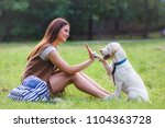 young woman playing with cute... | Shutterstock . vector #1104363728