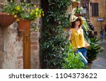 young woman traveler walking on ... | Shutterstock . vector #1104373622