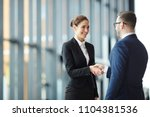 young smiling businesswoman... | Shutterstock . vector #1104381536