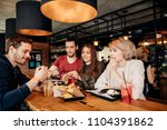 friends eating french fries and ... | Shutterstock . vector #1104391862